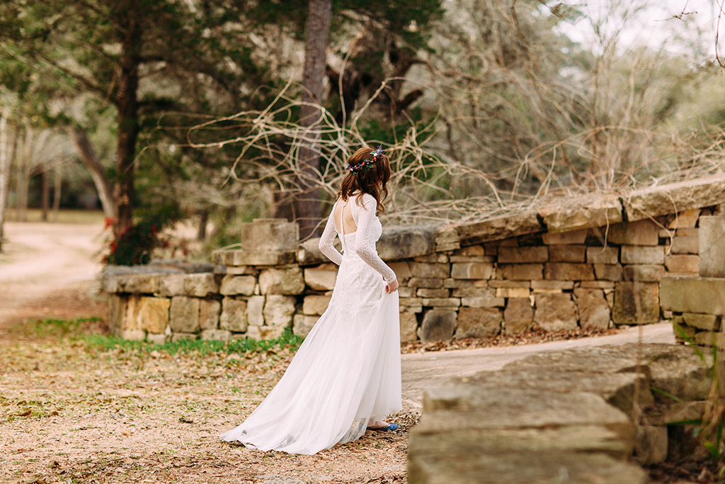 beautiful whimsical bohemian bride wearing a floral crown in Round Top Texas