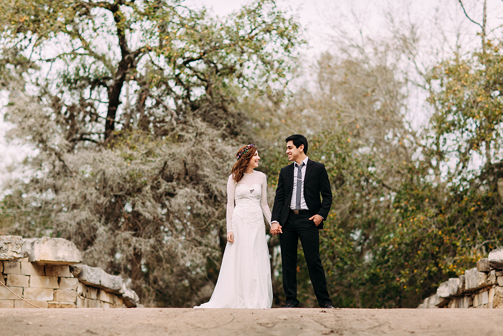 bride and groom holding hands in round top texas for their wedding