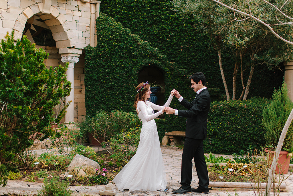 portraits of a bohemian whimsical bride and groom on wedding day in Round Top Texas hillcountry