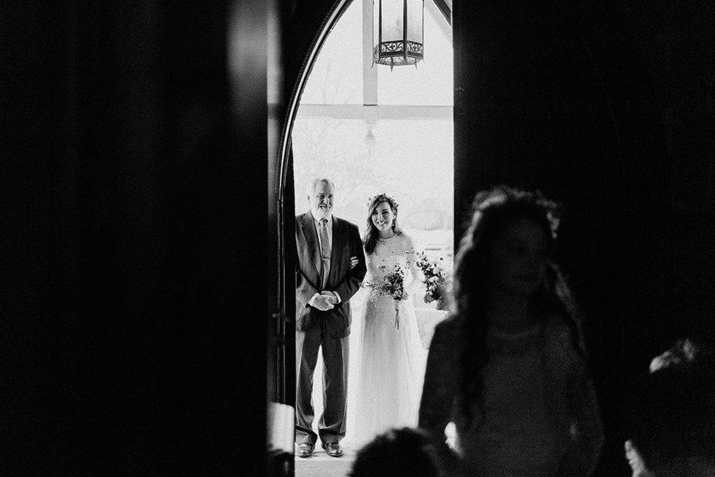 father of the bride in the doorway of the church chapel in round top texas