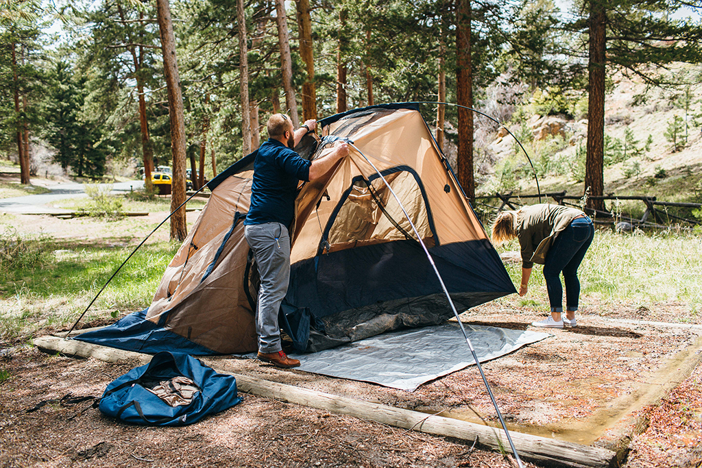 a couple putting up a camping tent in Rocky Mountain State Park