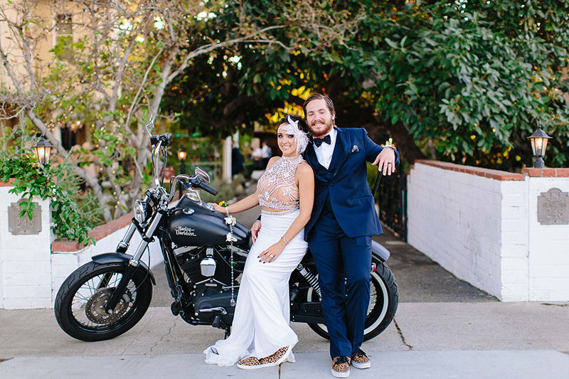 bride and groom portriat with a motorcycle