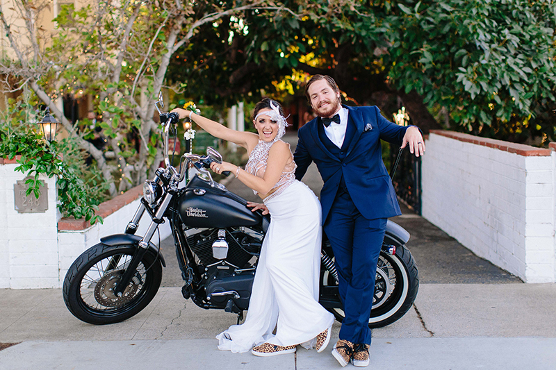 bride and groom portraits with a motorcycle