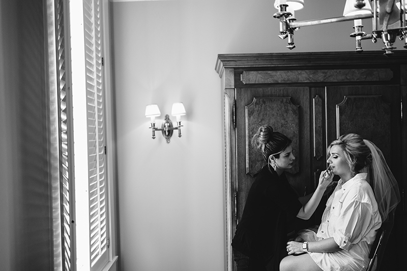 bride getting makeup done at Tremont House, Galveston Texas Wedding