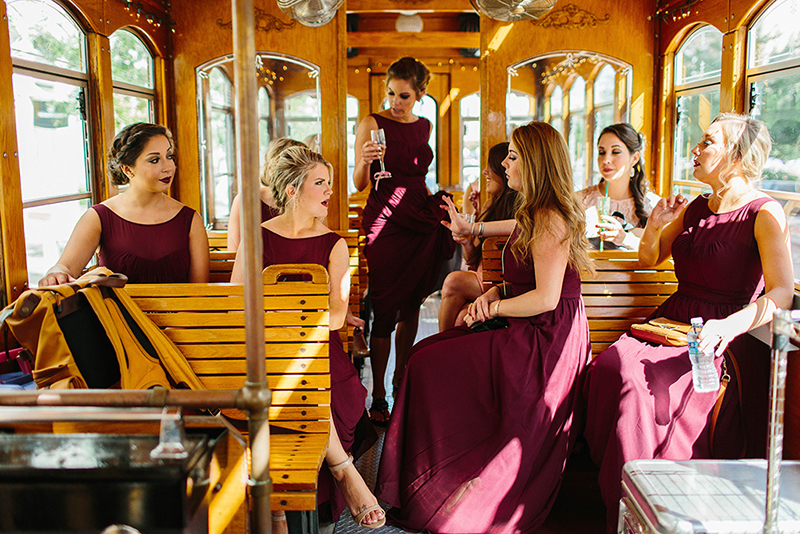 bridesmaids sitting on a trolley in Galveston Texas