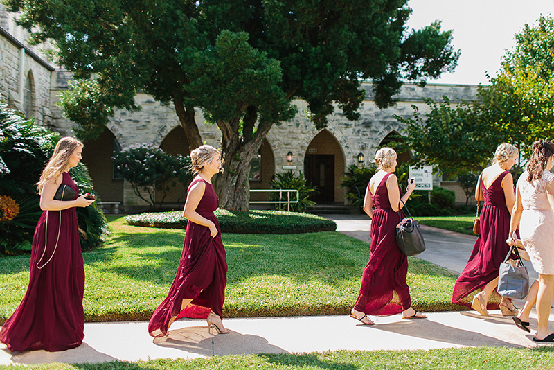 bridesmaids walking infront of the Grace Episcopal Church