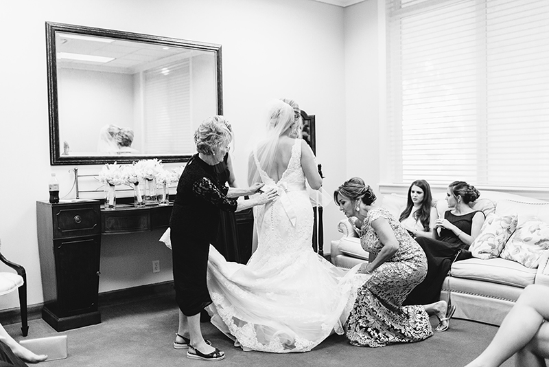 bride getting ready inside the Grace Episcopal Church in Galveston Texas