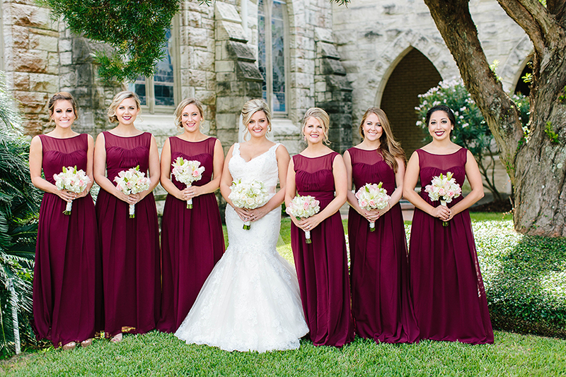 Marsala colored bridesmaids dresses infront of the Grace Episcopal Church