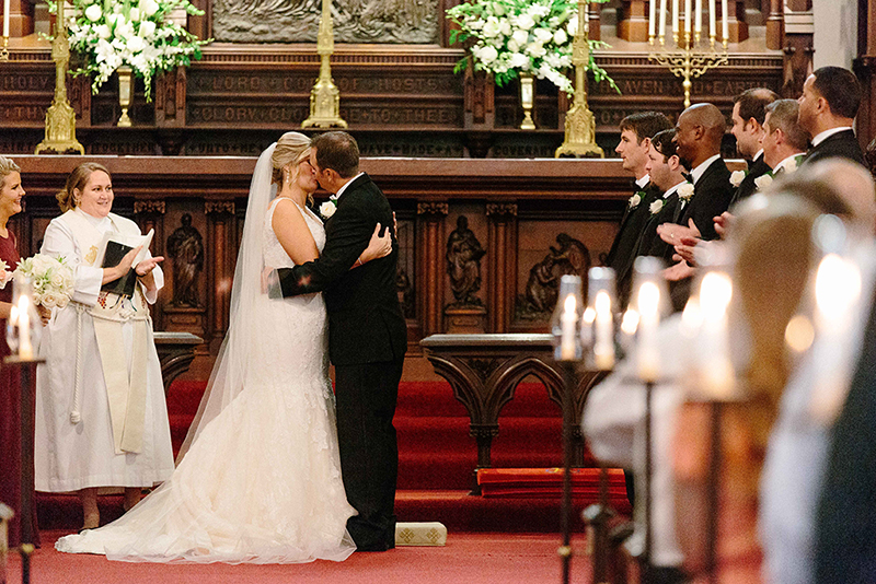 bride and groom kissing in the Grace Episcopal Church