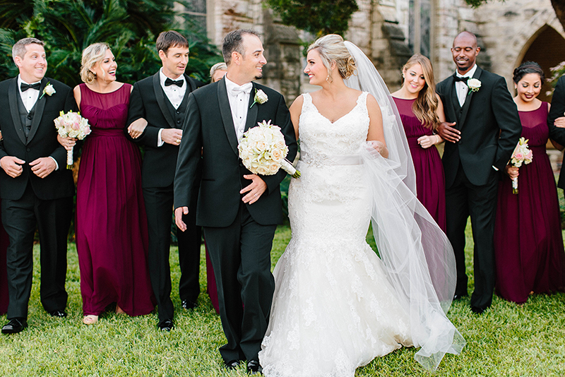 Beautiful wedding party wearing Fall colors infront the Grace Episcopal Church