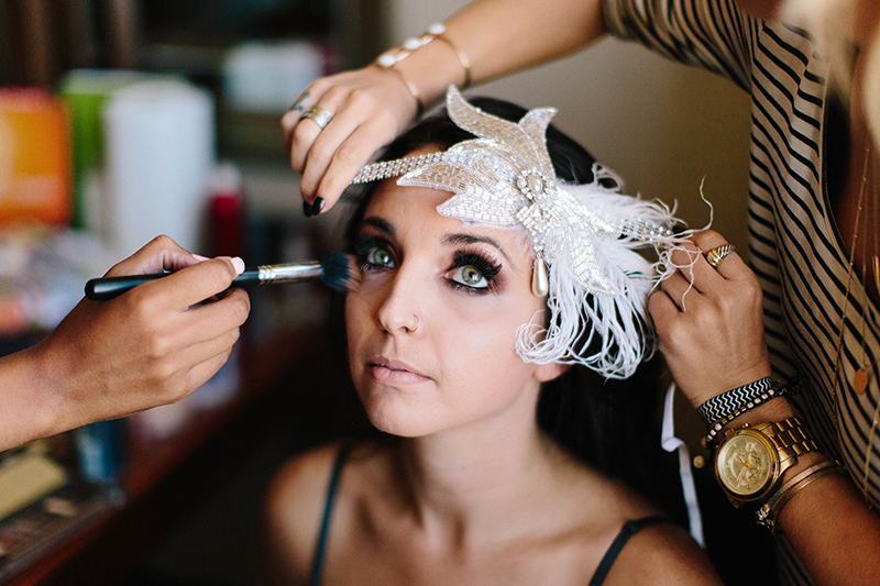 a bride getting ready in her hotel for a wedding in Orange County California getting her makeup done