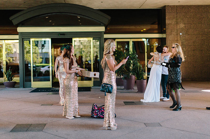 bridesmaids outside a hotel with sequin dresses on