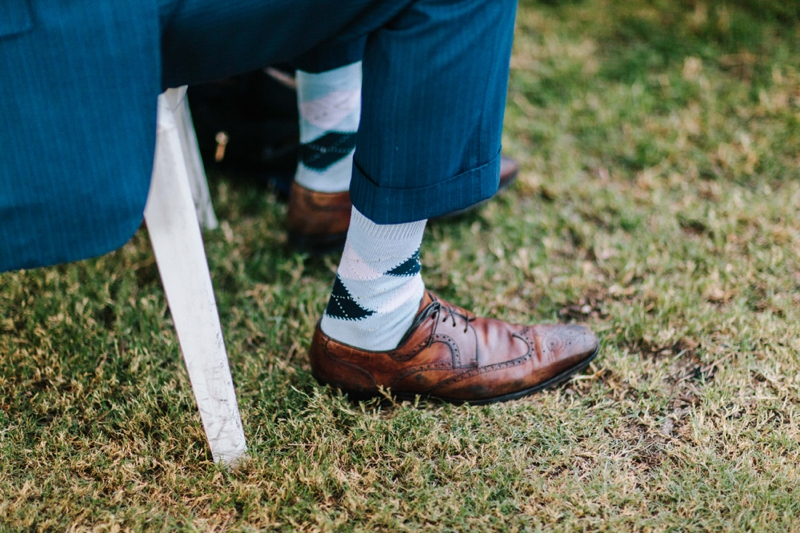 a man wearing dress socks and oxfords