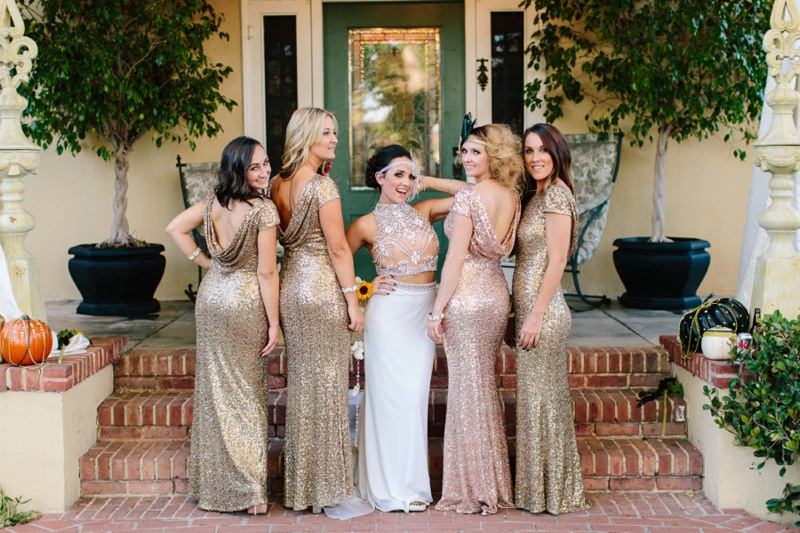 group of bridesmaids wearing gold sequin dresses