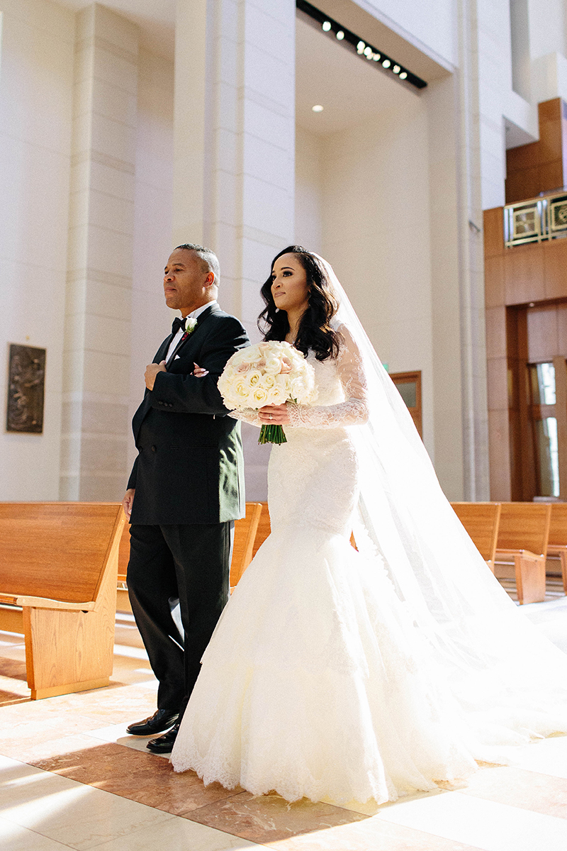 father walking his daughter the bride down the aisle Co-Cathedreal of the Sacred Heart in Houston, Texas