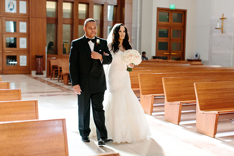 Co-Cathedreal of the Sacred Heart in Houston, Texas father walking her daughter down the aisle.