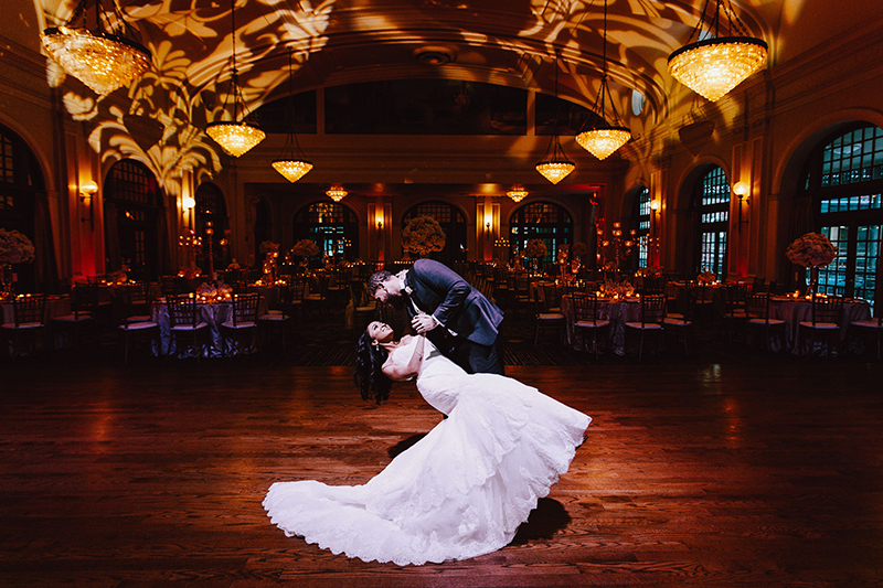 groom dipping his bride in wedding reception at the Crystal Ballroom at the Rice Hotel in Houston, Texas