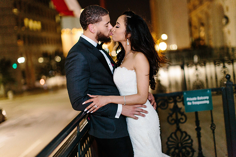 portrait of bride and groom kissing wedding reception at the Crystal Ballroom at the Rice Hotel in Houston, Texas